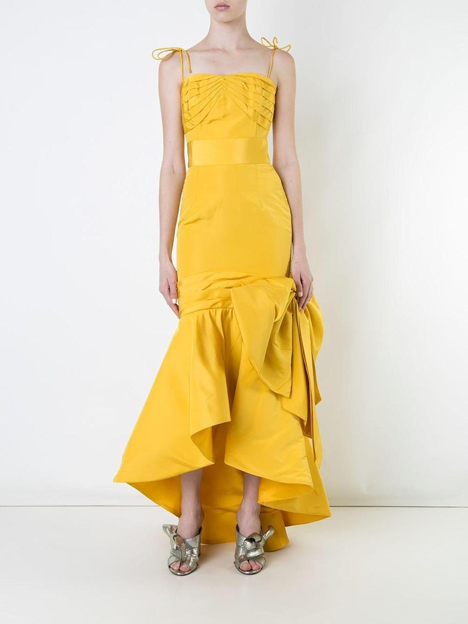 """<h2>Bambah Mermaid Gown In Marigold</h2><br>This 100% silk fluted gown would have made a statement in plain white, but in a brilliant shade of sunshine yellow, it's bound to make your special day even more unforgettable. (It's also in major markdown mode with plentiful sizes remaining.)<br><br><em>Shop Bambah at <strong><a href=""""https://www.farfetch.com/shopping/women/bambah/items.aspx"""" rel=""""nofollow noopener"""" target=""""_blank"""" data-ylk=""""slk:Farfetch"""" class=""""link rapid-noclick-resp"""">Farfetch</a></strong></em><br><br><strong>Bambah</strong> Mermaid Effect Gown, $, available at <a href=""""https://go.skimresources.com/?id=30283X879131&url=https%3A%2F%2Fwww.farfetch.com%2Fshopping%2Fwomen%2Fbambah-mermaid-effect-gown-item-12118951.aspx%3Fstoreid%3D10735"""" rel=""""nofollow noopener"""" target=""""_blank"""" data-ylk=""""slk:Farfetch"""" class=""""link rapid-noclick-resp"""">Farfetch</a>"""