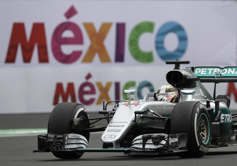 FILE - In this Oct. 28, 2016, file photo, Mercedes driver Lewis Hamilton steers his car during the first practice session for the Formula One Mexico Grand Prix auto race at the Hermanos Rodriguez racetrack in Mexico City. More than 60 years since Argentina's Juan Manuel Fangio conquered F1 in the 1950s, Hamilton is on the verge tying his title haul this weekend at the Mexican Grand Prix. (AP Photo/Rebecca Blackwell, File)