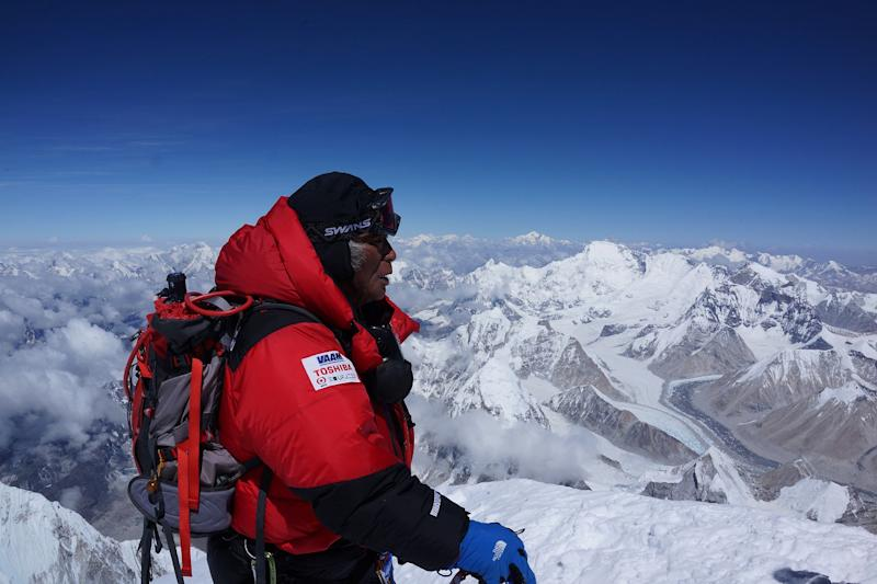 In this photo distributed by MIURA DOLPHINS CO., LTD., 80-year-old Japanese extreme skier Yuichiro Miura, right, who has had four heart operations in recent years, stands atop the summit of Mount Everest as he becomes the oldest person to climb the world's tallest mountain Thursday, May 23, 2013. Miura, who also conquered the 29,035-foot (8,850-meter) peak when he was 70 and 75, reached the summit at 9:05 a.m. local time, according to a Nepalese mountaineering official and Miura's Tokyo-based support team. (AP Photo/MIURA DOLPHINS CO., LTD.) MANDATORY CREDIT