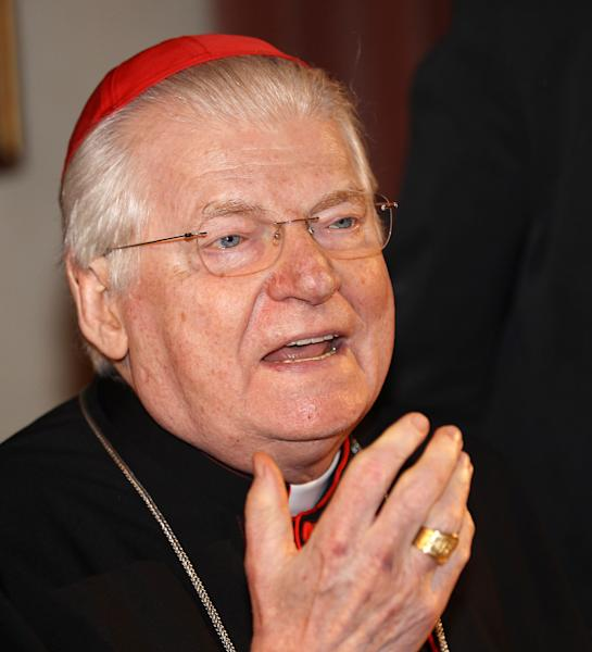 In this photo taken May 18, 2012 photo Cardinal Angelo Scola, Archbishop of Milan, gestures during a press conference in Milan, Italy. Angelo Scola, the archbishop of Milan, is seen as Italy's best chance at reclaiming the papacy, following back-to-back popes from outside the country that had a lock on the job for centuries. The powerful cardinal displays not only an ease with youth but also a desire to make himself understood _ a vital quality for a church that is bleeding membership. (AP Photo/Antonio Calanni)