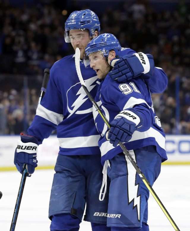 Tampa Bay Lightning center Steven Stamkos (91) celebrates his goal against the Winnipeg Jets with defenseman Victor Hedman (77) during the second period of an NHL hockey game Tuesday, March 5, 2019, in Tampa, Fla. (AP Photo/Chris O'Meara)