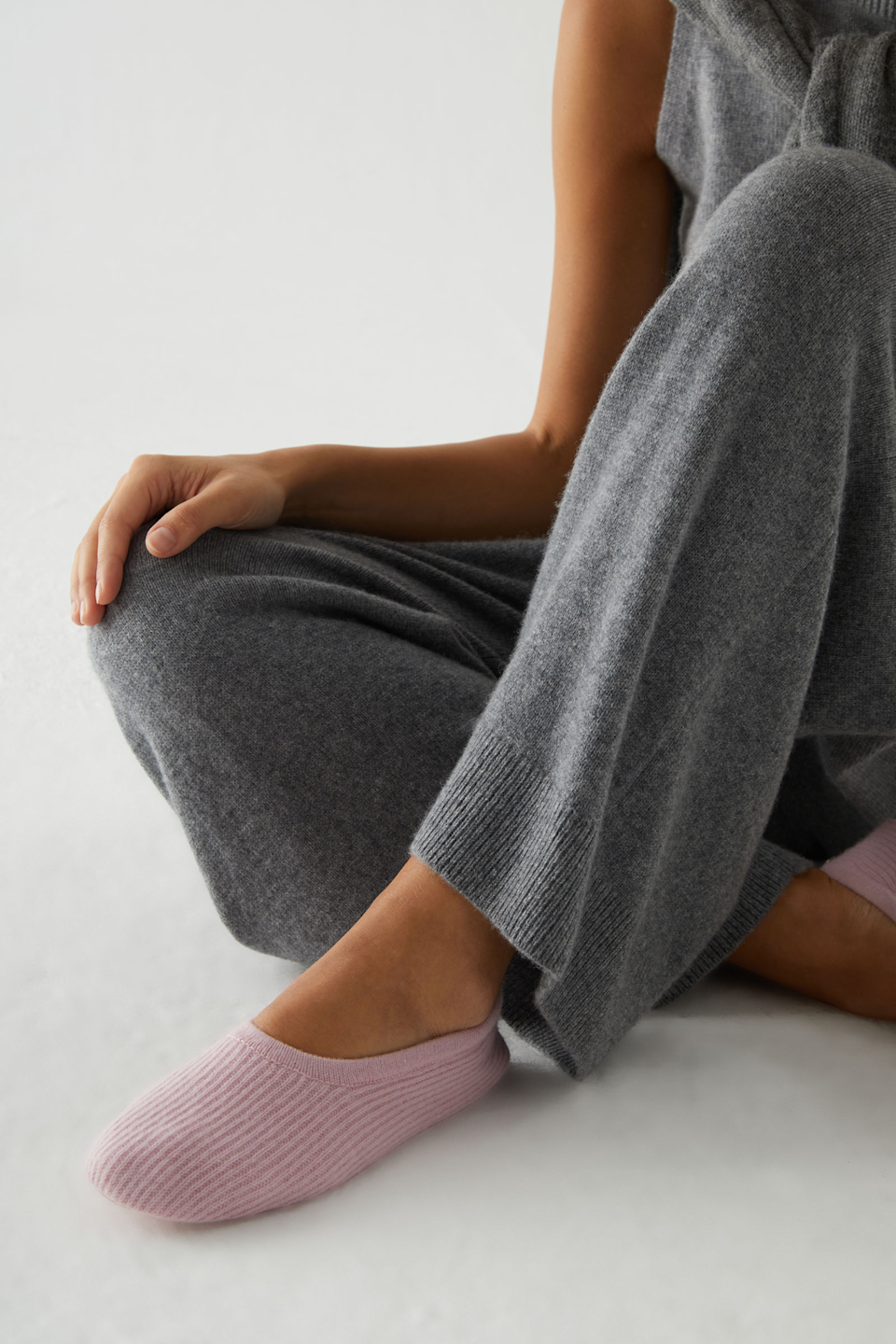 "For the friend who's perpetually freezing and won't let you turn your radiator off even when it's boiling hot.<br><br><strong>COS</strong> Ribbed Cashmere Slippers, $, available at <a href=""https://go.skimresources.com/?id=30283X879131&url=https%3A%2F%2Fwww.cosstores.com%2Fen_usd%2Fwomen%2Faccessories%2Fproduct.ribbed-cashmere-slippers-pink.0760298007.html"" rel=""nofollow noopener"" target=""_blank"" data-ylk=""slk:COS"" class=""link rapid-noclick-resp"">COS</a>"