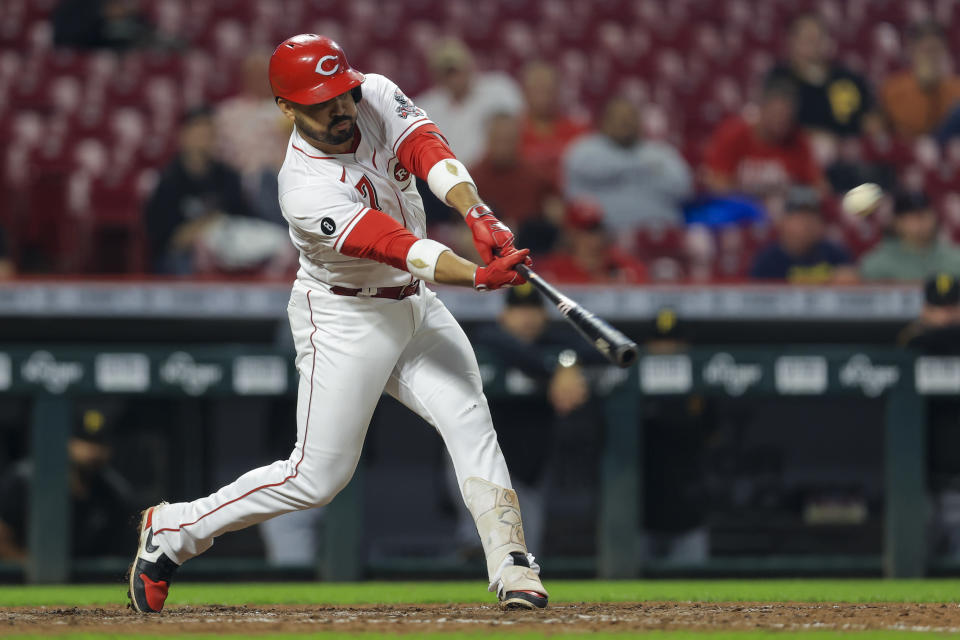 Cincinnati Reds' Eugenio Suarez hits a solo home run during the fifth inning of a baseball game against the Pittsburgh Pirates in Cincinnati, Monday, Sept. 20, 2021. (AP Photo/Aaron Doster)