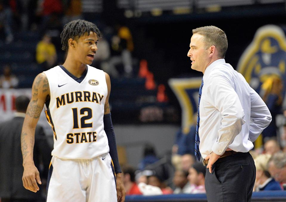 Murray State guard Ja Morant (12) talks with Murray State head coach Matt McMahon during the second half of an NCAA college basketball game against SIU Edwardsville in Murray, Ky., Saturday, Feb. 9, 2019. (AP Photo/Timothy D. Easley)