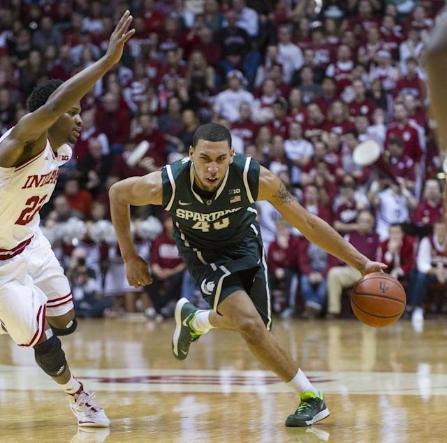 Michigan State's Denzel Valentine (45) makes a break past Indiana's Stanford Robinson (22) in the first half of an NCAA college basketball game, Saturday, Jan. 4, 2014, in Bloomington, Ind. (AP Photo/Doug McSchooler)