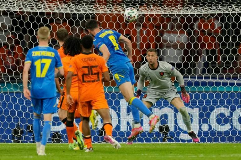 Ukraine looked set to leave with a draw when Roman Yaremchuk (C) equalised late on