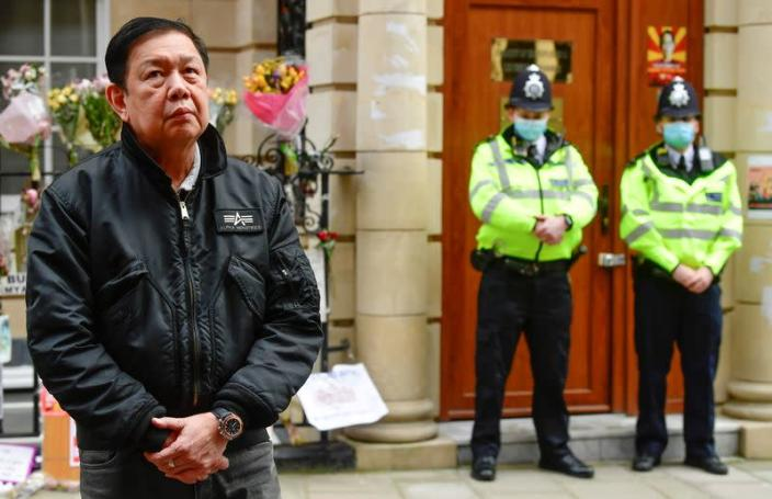 Myanmar's ambassador Kyaw Zwar Minn stands outside the Myanmar Embassy in London