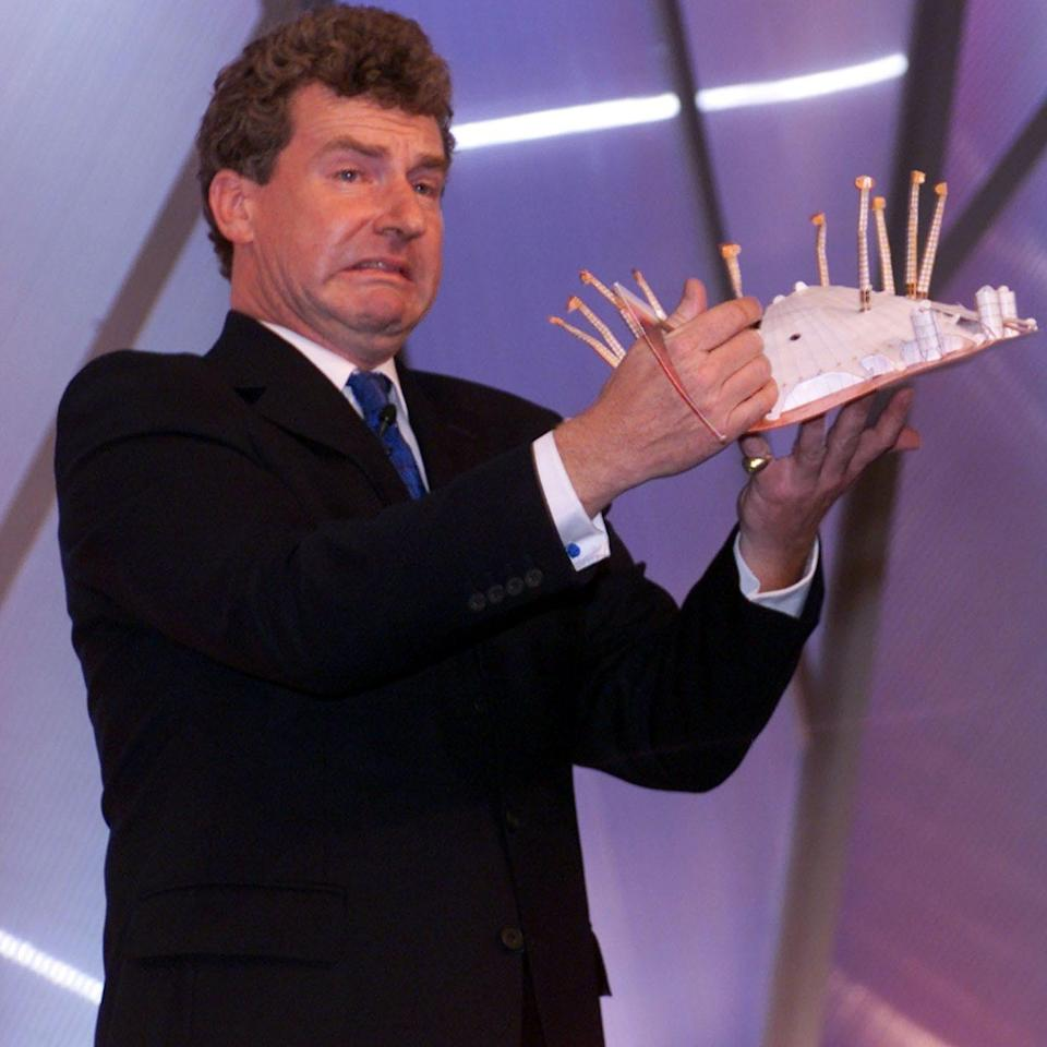 Ainsworth at the 2000 Tory Party conference with a model of the Millennium Dome (now the 02 arena): though he had supported the building of the Dome, he was critical of what he saw as its mismanagement by the Labour government - Paul Grover