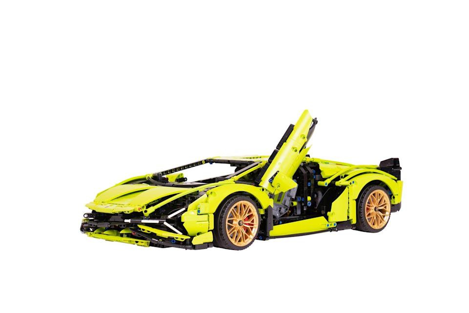 """<p>This 3,696-piece LEGO Technic 1:8 scale model car brings you closer than ever to the real Lamborghini Sian FKP 37. Features include a V12 engine with moving pistons, steering, front and rear suspension and rear spoiler, and opening scissor doors. </p><p><a class=""""link rapid-noclick-resp"""" href=""""https://go.redirectingat.com?id=127X1599956&url=https%3A%2F%2Fwww.argos.co.uk%2Fproduct%2F8094489&sref=https%3A%2F%2Fwww.housebeautiful.com%2Fuk%2Flifestyle%2Fshopping%2Fg33533336%2Fargos-christmas-toys-2020%2F"""" rel=""""nofollow noopener"""" target=""""_blank"""" data-ylk=""""slk:BUY NOW VIA ARGOS"""">BUY NOW VIA ARGOS</a></p><p>•Also available at the <strong><a href=""""https://go.redirectingat.com?id=127X1599956&url=https%3A%2F%2Fwww.lego.com%2Fen-gb%2Fproduct%2Flamborghini-sian-fkp-37-42115&sref=https%3A%2F%2Fwww.housebeautiful.com%2Fuk%2Flifestyle%2Fshopping%2Fg33533336%2Fargos-christmas-toys-2020%2F"""" rel=""""nofollow noopener"""" target=""""_blank"""" data-ylk=""""slk:LEGO shop"""" class=""""link rapid-noclick-resp"""">LEGO shop</a></strong>. </p>"""