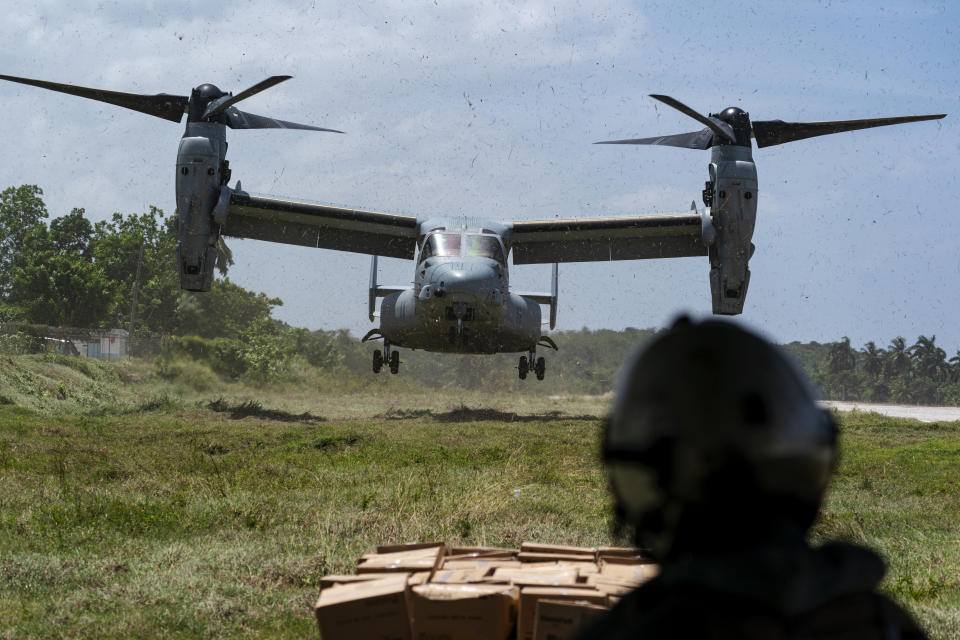 """A VM-22 Osprey, with a load of aid lands, at Jeremie Airport, Saturday, Aug. 28, 2021, in Jeremie, Haiti. The VMM-266, """"Fighting Griffins,"""" from Marine Corps Air Station New River, from Jacksonville, N.C., are flying in support of Joint Task Force Haiti after a 7.2 magnitude earthquake on Aug. 22, caused heavy damage to the country. (AP Photo/Alex Brandon)"""
