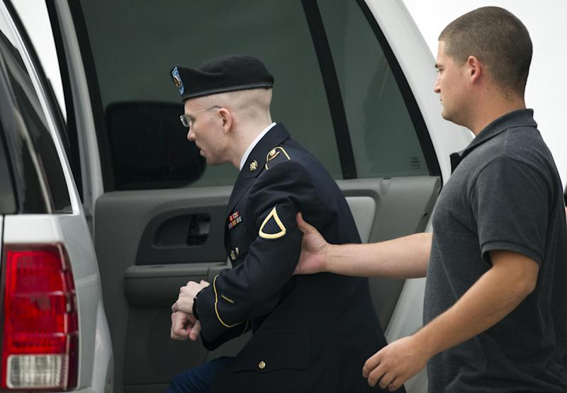 Army Pfc. Bradley Manning is escorted into a vehicle at Fort Mead, Md, Thursday, July 25, 2013. Manning is charged with indirectly aiding the enemy by sending troves of classified material to WikiLeaks. He faces up to life in prison. (AP Photo/Cliff Owen))