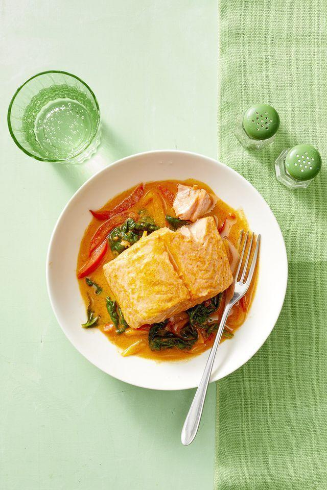 """<p>As the salmon fillets cook in this sweet and spicy coconut curry, they absorb some of its elements. Spoon a little of the cooking liquid over the finished dish to really bring those flavors forward. </p><p><em><a href=""""https://www.womansday.com/food-recipes/food-drinks/a22690236/curry-poached-salmon-with-peppers-recipe/"""" rel=""""nofollow noopener"""" target=""""_blank"""" data-ylk=""""slk:Get the recipe for Curry-Poached Salmon with Peppers"""" class=""""link rapid-noclick-resp"""">Get the recipe for Curry-Poached Salmon with Peppers</a></em></p>"""