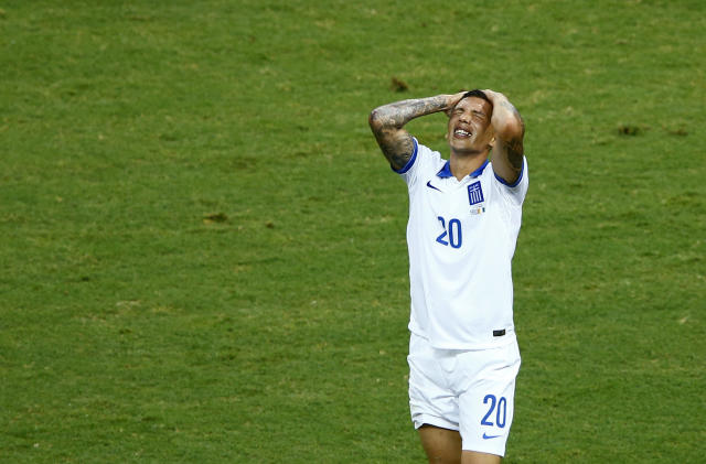Greece's Holebas reacts after missing a shot at goal during their 2014 World Cup Group C soccer match against Ivory Coast in Fortaleza