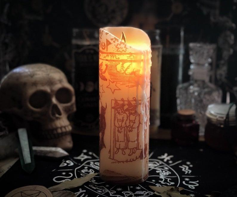 """<p>This <a href=""""https://www.popsugar.com/buy/9-Inch-Black-Flame-Pillar-Candle-479849?p_name=9-Inch%20Black%20Flame%20Pillar%20Candle&retailer=etsy.com&pid=479849&price=49&evar1=casa%3Aus&evar9=46498152&evar98=https%3A%2F%2Fwww.popsugar.com%2Fphoto-gallery%2F46498152%2Fimage%2F46498166%2F9-Inch-Black-Flame-Pillar-Candle&list1=halloween%2Ccandles%2Chocus%20pocus&prop13=api&pdata=1"""" rel=""""nofollow"""" data-shoppable-link=""""1"""" target=""""_blank"""" class=""""ga-track"""" data-ga-category=""""Related"""" data-ga-label=""""http://www.etsy.com/listing/704639297/black-flame-candle-hocus-pocus-inspired?ga_order=most_relevant&amp;ga_search_type=all&amp;ga_view_type=gallery&amp;ga_search_query=black+flame+candle&amp;ref=sr_gallery-1-24&amp;organic_search_click=1&amp;bes=1"""" data-ga-action=""""In-Line Links"""">9-Inch Black Flame Pillar Candle</a> ($49) is intricately designed and inspired by the one used in the movie.</p>"""
