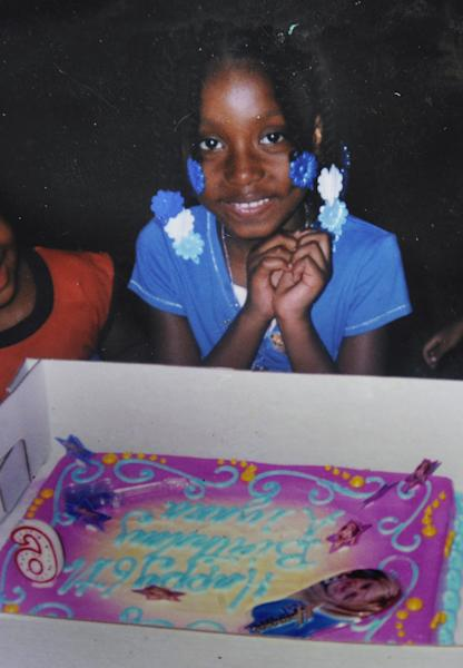 This undated family photo shows Aiyana Jones at her sixth birthday party. Wayne County Judge Cynthia Gray Hathaway declared a mistrial Tuesday, June 18, 2013, after jurors failed to reach a verdict in the trial of a Detroit police officer who fatally shot Jones during a chaotic search for a murder suspect that was recorded by a reality TV crew. (AP Photo/Family Photo via The The Detroit News) NO SALES