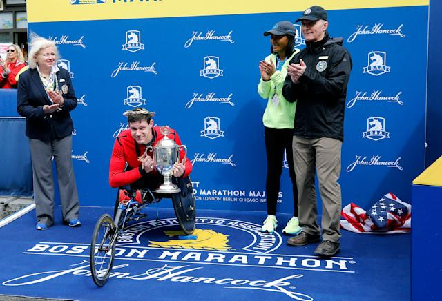 The Boston Athletic Association apologized that the American flag was on the ground during the men's wheelchair award ceremony. (AP Photo/Winslow Townson)