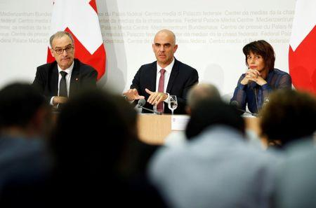 Swiss Defence Minister Guy Parmelin (L-R), Interior Minister Alain Berset and Energy Minister Doris Leuthard attend a news conference in Bern September 25, 2016. REUTERS/Ruben Sprich