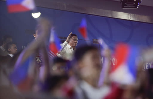 Philippine President Rodrigo Duterte waves as he attends the opening ceremonies of the 30th South East Asian Games at the Philippine Arena, Bulacan province, northern Philippines on Saturday, Nov. 30, 2019. (AP Photo/Aaron Favila)