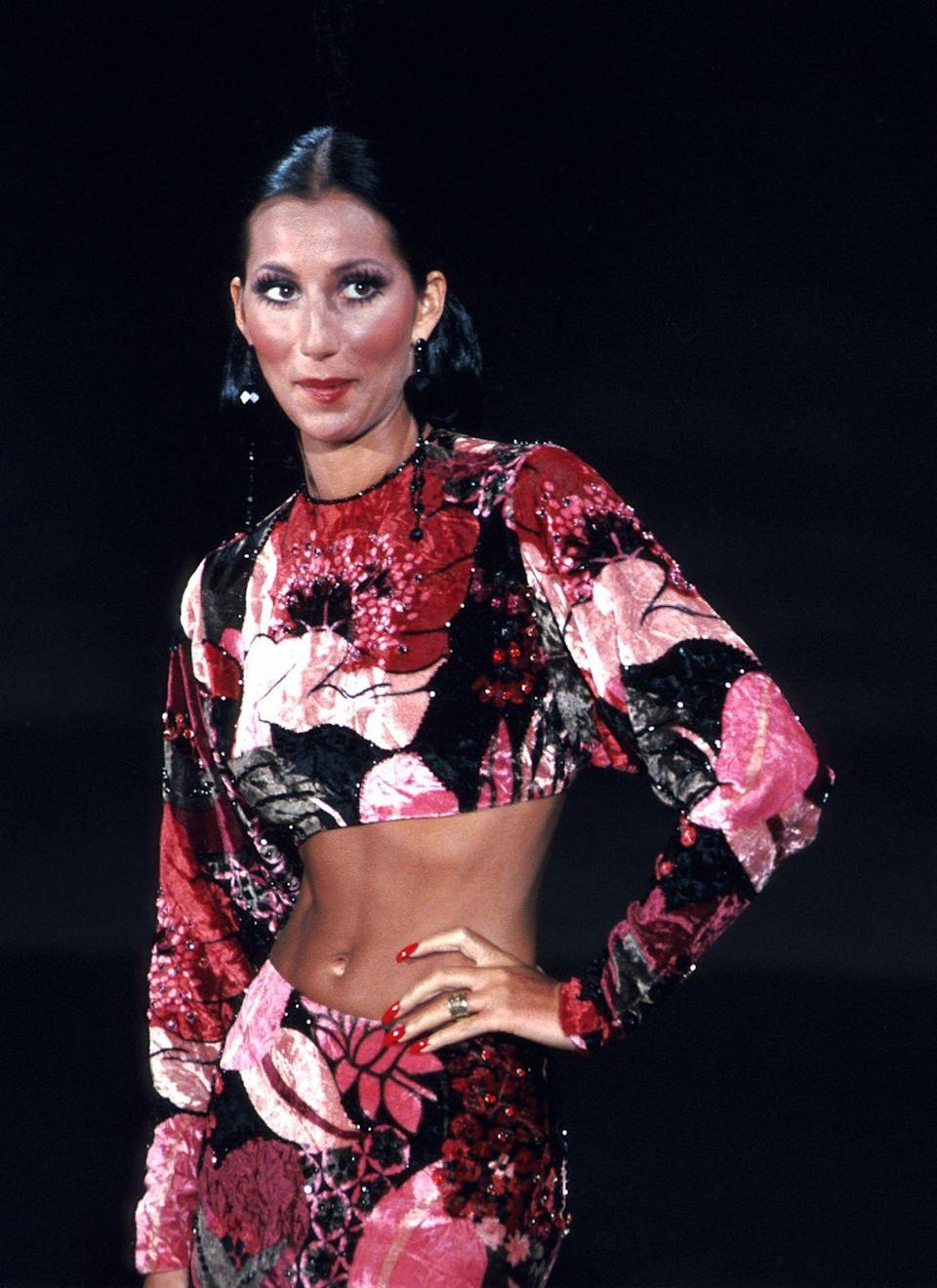<p>Wearing a floral two-piece outfit and drop earrings while performing. </p>