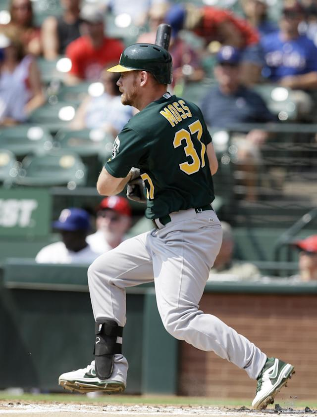 Oakland Athletics' Brandon Moss (37) follows through on a run-scoring double off a pitch from Texas Rangers' Yu Darvish in the first inning of a baseball game, Saturday, Sept. 14, 2013, in Arlington, Texas. The hit scored Josh Donaldson. (AP Photo/Tony Gutierrez)