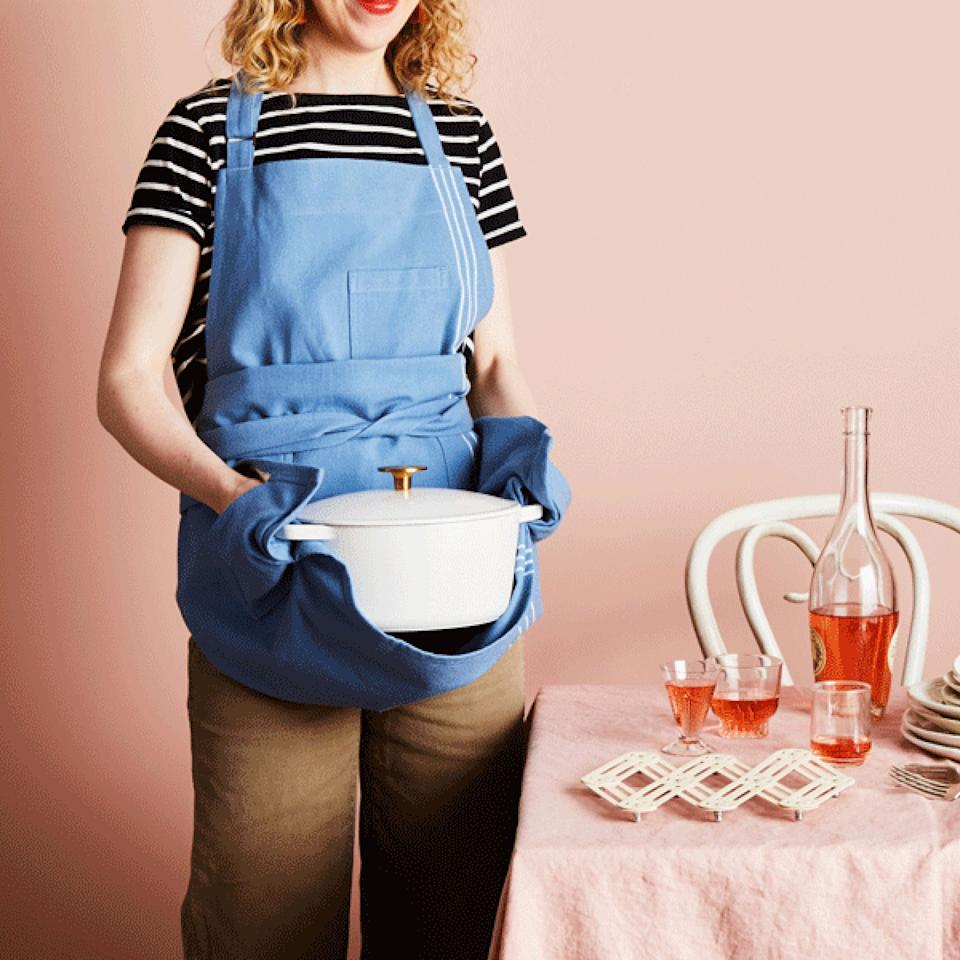 """Toss out that old apron — this one doesn't just handle all those """"splatters, splashes and spills."""" It has pockets that double as oven mitts or pot holders for your friend's just-baked desserts and delicacies.<a href=""""https://fave.co/34h28f6"""" target=""""_blank"""" rel=""""noopener noreferrer"""">Find it $45 at Food52</a>."""
