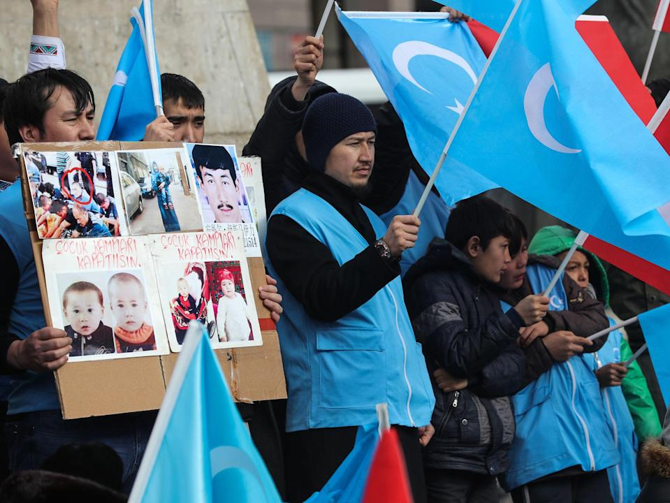 <p>Uighurs in Turkey stage a rally earlier this year to remember a massacre in Xinjiang</p> (AFP via Getty Images)