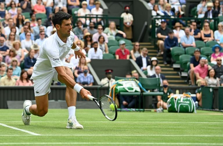 Sweet and low: Novak Djokovic returns against Chile's Cristian Garin during their fourth round match