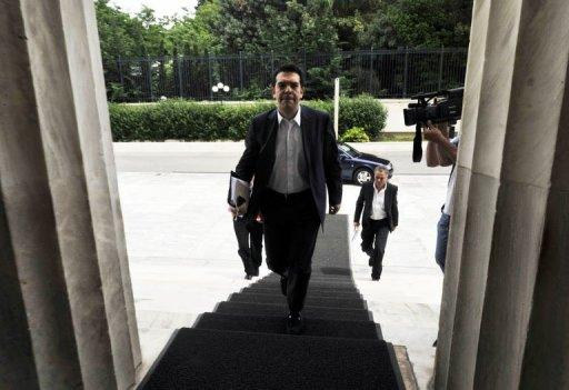 The Greek leader of the Radical Left (Syriza) coalition, Alexis Tsipras, arrives at parliament in Athens. The head of Greece's radical left-wing Syriza party said Tuesday his cabinet will reject all austerity measures imposed under an EU-IMF loan deal, if he manages to form a new government