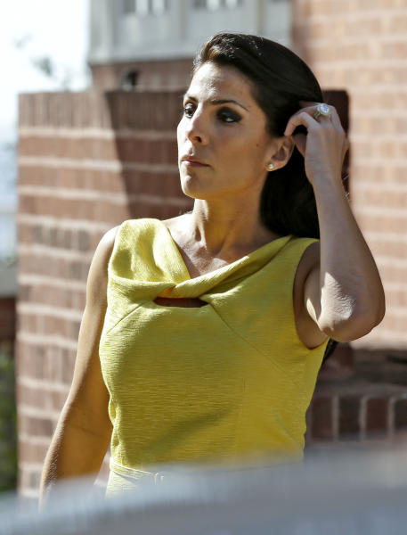 Jill Kelley leaves her home Monday, Nov 12, 2012 in Tampa, Fla. Kelley is identified as the woman who allegedly received harassing emails from Gen. David Petraeus' paramour, Paula Broadwell. She serves as an unpaid social liaison to MacDill Air Force Base in Tampa, where the military's Central Command and Special Operations Command are located. (AP Photo/Chris O'Meara)