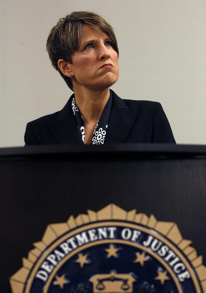 Laura E. Duffy, United States Attorney Southern District of California, pauses during a news briefing as she announces the indictment of five suspects related to the death of U.S. Border Patrol agent Brian Terry, Monday, July 9, 2012, in Tucson, Ariz. A reward of up to $1 million dollars for information leading to the arrest of four fugitives was also announced by Department of Justice officials, as one suspect is already in custody.(AP Photo/Ross D. Franklin)