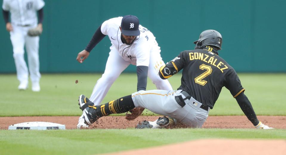 Pittsburgh Pirates second baseman Erik Gonzalez (2) slides safely into second ahead of the tag by Detroit Tigers second baseman Willi Castro (9) during first inning action Thursday, April 22, 2021 at Comerica Park in Detroit.