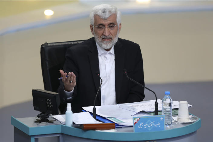 In this photo made available by the government-affiliated Young Journalists Club, presidential candidate Saeed Jalili speaks in a televised debate in a state-run television studio, in Tehran, Iran, on Saturday, June 5, 2021. Elections are scheduled for June 18. (Morteza Fakhri Nezhad/YJC via AP)