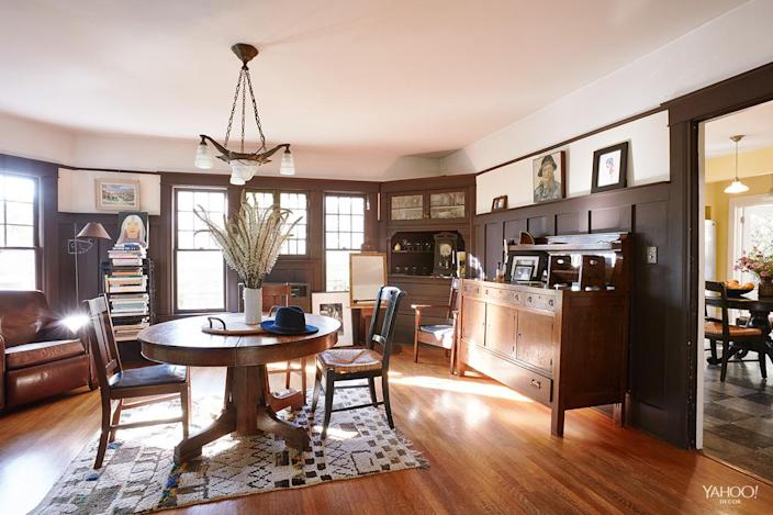 <p>The dining room is full of built-ins and original moldings. We got the oak table at a random antique store and brought the ceiling lamp back from France in our suitcase.</p>