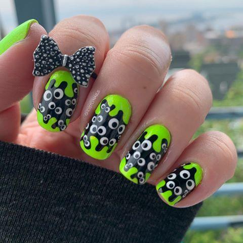 """<p>Kids and adults alike will love the look (heh) of these fun (and funny!) googly eyes nails. Swap the green background for any color you like. With this many eyes, invest in a set of dotting tools.</p><p><a class=""""link rapid-noclick-resp"""" href=""""https://www.amazon.com/JSDOIN-Dotting-Tool-Paint-Manicure/dp/B07GBS9WLX/?tag=syn-yahoo-20&ascsubtag=%5Bartid%7C10050.g.33512580%5Bsrc%7Cyahoo-us"""" rel=""""nofollow noopener"""" target=""""_blank"""" data-ylk=""""slk:SHOP DOTTING TOOLS FOR NAILS"""">SHOP DOTTING TOOLS FOR NAILS </a></p><p><a href=""""https://www.instagram.com/p/CDPfMAUDUkY/?utm_source=ig_embed&utm_campaign=loading"""" rel=""""nofollow noopener"""" target=""""_blank"""" data-ylk=""""slk:See the original post on Instagram"""" class=""""link rapid-noclick-resp"""">See the original post on Instagram</a></p>"""