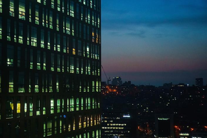 Windows light up in the evening in Seoul