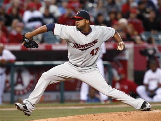 Minnesota Twins pitcher Francisco Liriano throws to the Los Angeles Angels during the first inning of a baseball game in Anaheim, Calif., on Tuesday, May 1, 2012. (AP Photo/Christine Cotter)