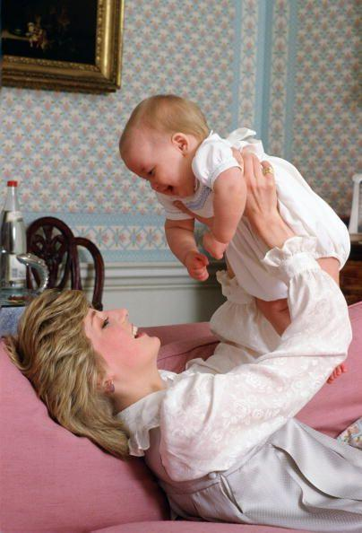 <p>The Princess plays with her smiley firstborn, William, at home in Kensington Palace in this photo taken in February 1983.</p>