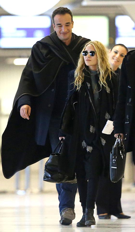 Exclusive... 50984062 Actress and fashionista Mary-Kate Olsen departing on a flight at Roissy airport in Paris, France with her much older French boyfriend Olivier Sarkozy on January 6th, 2013. The happy couple aren't afraid to show some PDA while they wait for their flight. No Internet Use Without Prior Agreement  FameFlynet, Inc - Beverly Hills, CA, USA -  1 (818) 307-4813 RESTRICTIONS APPLY: USA/AUSTRALIA ONLY