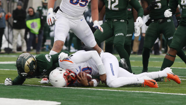 Colorado State safety Jamal Hicks, back, stops Boise State quarterback Jaylon Henderson just short of the end zone after a short gain in the first half of an NCAA college football game Friday, Nov. 29, 2019, in Fort Collins, Colo. (AP Photo/David Zalubowski)