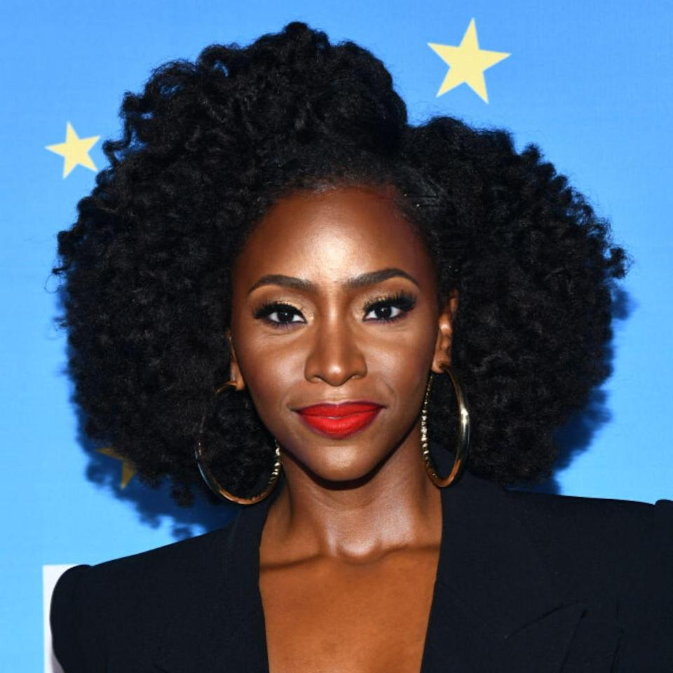 """Curly hair naturally wants to be voluminous, and 2020 is all about embracing and enhancing that. Consider your texture, face shape, and how you typically like to part your hair before you decide on which cut to go with. If you're into to a side part, look to Teyonah Parris. Hairstylist Anthony Dickey, the founder of Hair Rules Salon in New York City, says that in order to get a rounded 'fro """"all 4C textures should be cut [while] blown out straight."""" He also recommends avoiding shampoo that lathers to keep curls hydrated — not stripped dry. His own line, Hair Rules, includes the stellar <a href=""""https://hairrules.com/products/cleansing-cream"""" rel=""""nofollow noopener"""" target=""""_blank"""" data-ylk=""""slk:No Suds Cleansing Cream"""" class=""""link rapid-noclick-resp"""">No Suds Cleansing Cream</a>."""