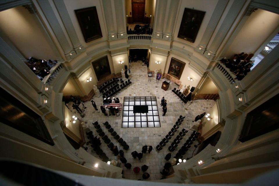 <p>Lewis then laid in state in the Georgia State Capitol. A military honor guard brought the Congressman's casket into the rotunda. Lewis represented Georgia's 5th congressional district from 1987 until his death on July 17. </p>