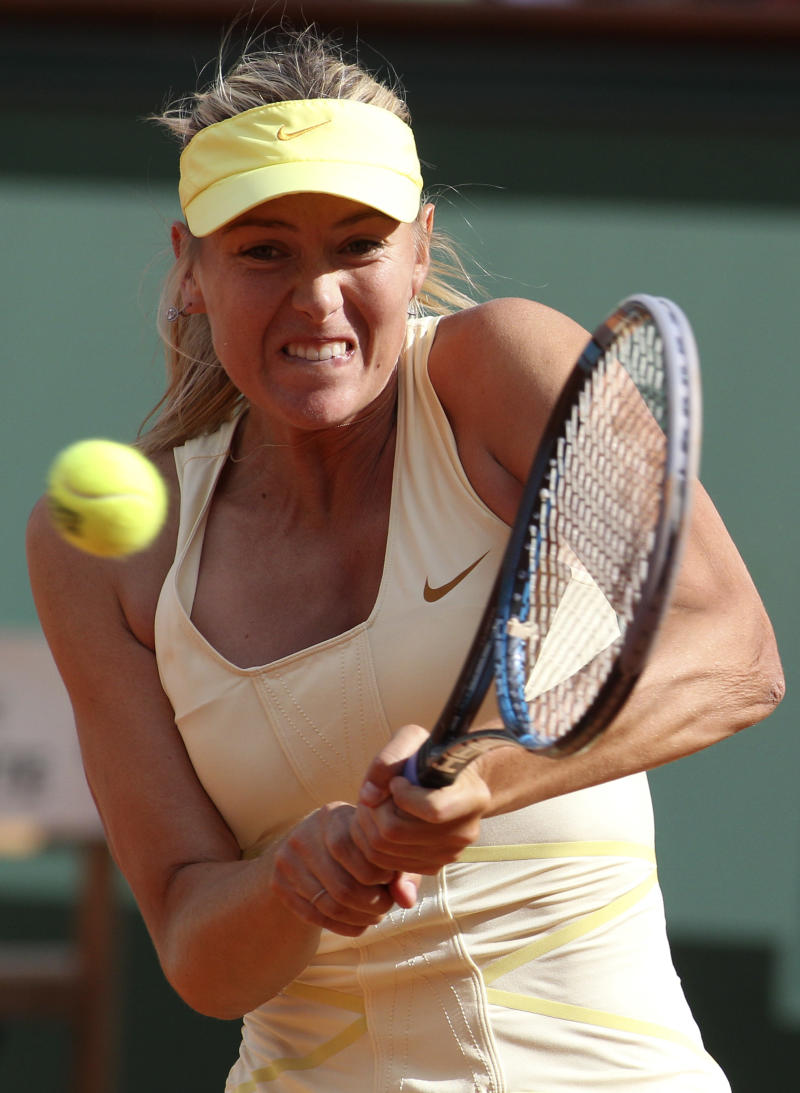 Russia's Maria Sharapova returns the ball to France's Caroline Garcia during their second round match of the French Open tennis tournament, at  the Roland Garros stadium in Paris, Thursday, May 26, 2011. (AP Photo/Michel Euler)