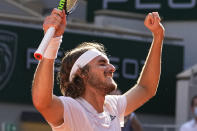 Stefanos Tsitsipas of Greece celebrates as he defeats Germany's Alexander Zverev during their semifinal match of the French Open tennis tournament at the Roland Garros stadium Friday, June 11, 2021 in Paris. (AP Photo/Michel Euler)