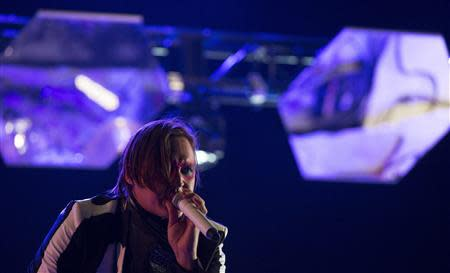 Lead vocalist Win Butler of rock band Arcade Fire performs at the Coachella Valley Music and Arts Festival in Indio