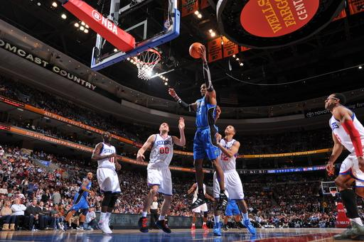 PHILADELPHIA, PA - APRIL 7:  Dwight Howard #12 of the Orlando Magic grabs a rebound over Spencer Hawes #00 and Evan Turner #12 of the Philadelphia 76ers on April 7, 2012 at the Wells Fargo Center in Philadelphia, Pennsylvania.    (Photo by Jesse D. Garrabrant/NBAE via Getty Images)