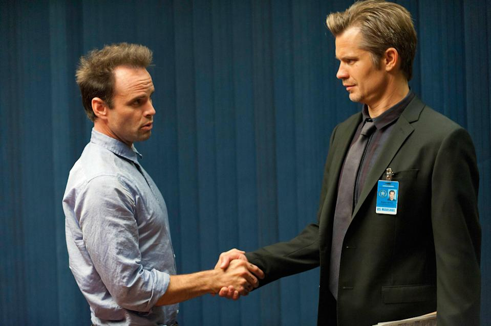 Walt Goggins and Timothy Olyphant shaking hands