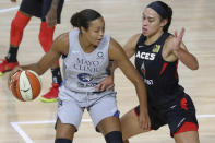 Minnesota Lynx's Napheesa Collier is defended by Las Vegas Aces' A'ja Wilson during the first half of a WNBA basketball game Thursday, Aug. 13, 2020, in Bradenton, Fla. (AP Photo/Mike Carlson)