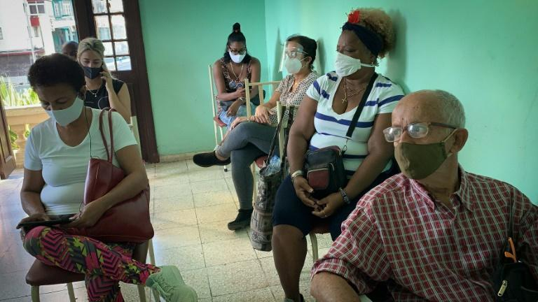 Hospital staff waiting to receive their Covid-19 vaccine at the Heroes of Corinth clinic in Havana