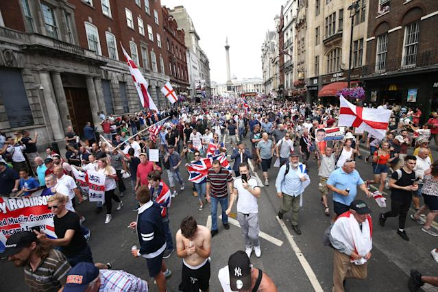 <p>Free Tommy Robinson supporters and pro-Trump supporters come together on Whitehall, London, for a joint rally in support of the visit of the U.S. president to the U.K. and calling for the release of jailed right-wing activist Tommy Robinson. (Photo: Yui Mok/PA Images via Getty Images) </p>