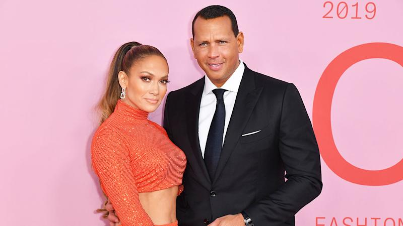 Seen here, Jennifer Lopez poses for a photo with baseball legend husband Alex Rodriguez.